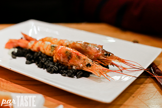 grilled prawn over squid ink wheat