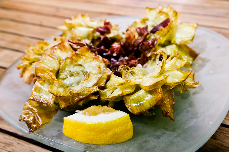 A ración of alcachofas fritas con jamon - fried artichokes with jamon
